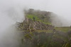 The morning fog that blanketed Machu Picchu finally starts to open up to give us a peek.