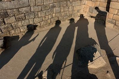 Machu Picchu Shadow Play - from left (Vilma, our guide/Ann/Jamie/Nestor/John