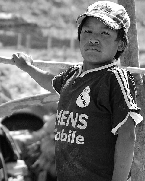 Proud child working at mining company in Huanca, Peru