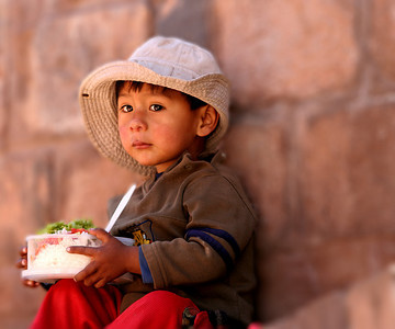 boy with lunch, Cusco, Peru