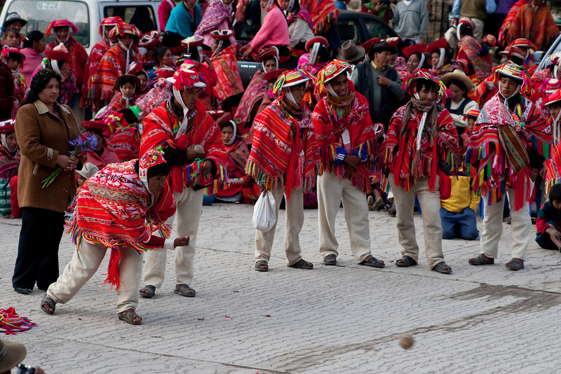 It was New Year's Day and there was a big event going on in the main square of Ollantaytambo. In these photos the locals were playing a game very similar to bowling where they would roll stones and try to knock down wooden posts.