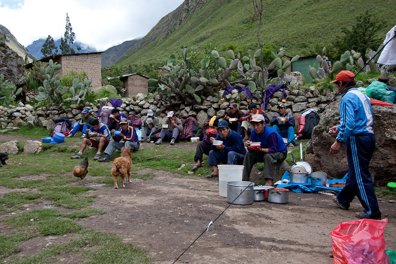 "I snuck a couple shots of the porters having their lunch. Some of them are giving me the ""why are you taking a photo of this?"" look, haha. Notice the dog and the chickens, there were a lot of random animals hanging around looking for scraps of food."