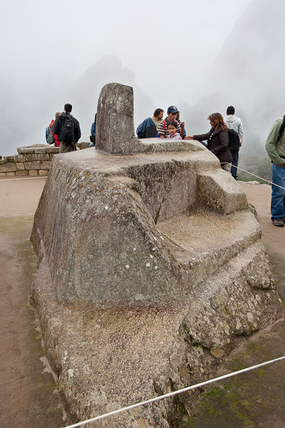 This is the Intiwatana stone. The four corners of the stone face the 4 cardinal points. The pillar on the top was used as a sun dial and could also predict the solstices and equinox. As you can see, the stone was carved from the existing rock on the mountain. It has been roped off to prevent people from touching or climbing on it, but many feel that the stone has a magical power that can be felt if you place your hand close to the rock.