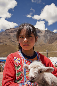 Girl with Lamb in the Andean Highlands, Peru