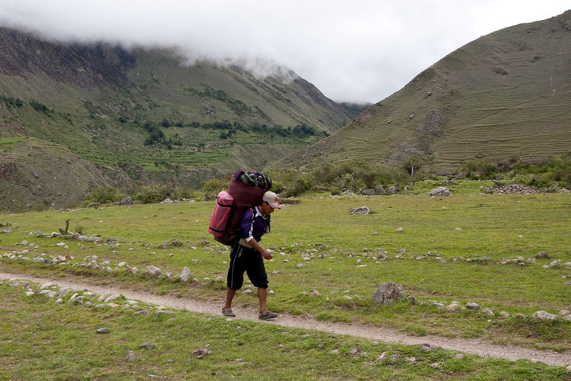 One of the porters carrying a typical size load. Pretty amazing, and most of them wore sandals or very basic shoes.