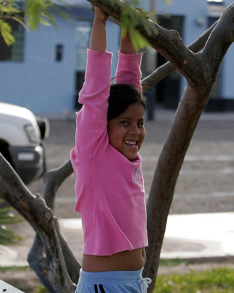 Girl playing in tree Peru