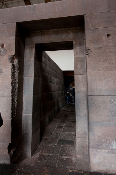 Doorway to the Cathedral of the Stars in Q'orichancha. This section of the cathedral was made of original inca walls. The damage in the stone is from the Spaniards stealing jewels and gold decorations that the Incas had put in the walls.