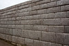 This Inca wall was described as the most perfect section of Ashlar (withouth mortar) wall in the country, as the stone blocks are still in perfect position as when it was constructed. The wall actually does not rise straight up vertically, it slightly angles away from the photographer's vantage.