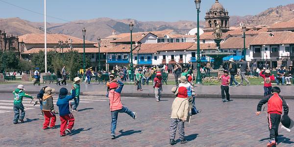 Boys dance in Plaza De Armas, Cuzco