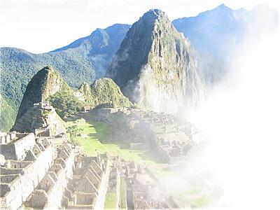 Machu Picchu in de wolken, Peru.