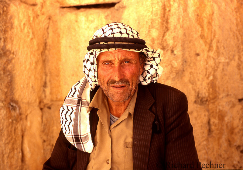 Palestinian worker taking a break to pose for his portrait.