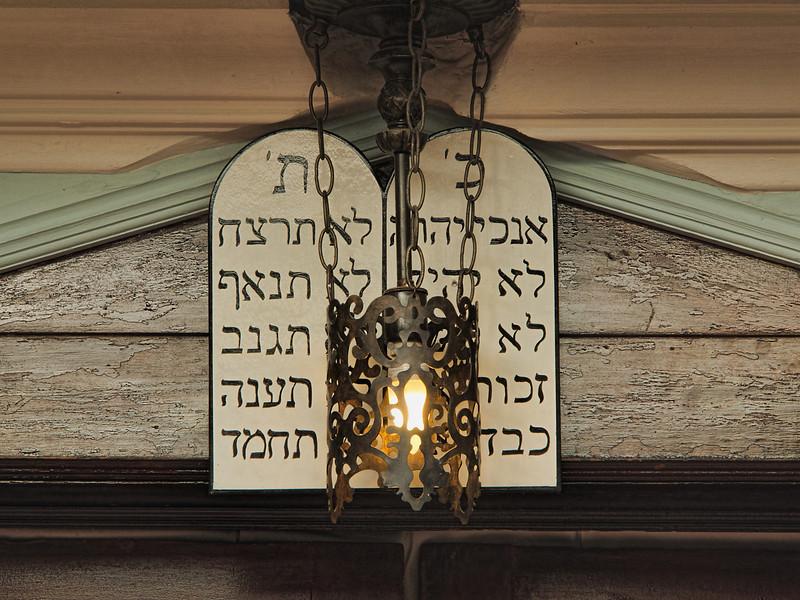The Eternal Flame illuminates the Ten Commandments.