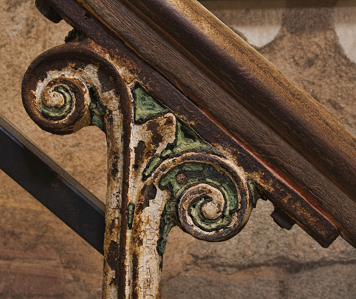 Surprisingly intricate design on stair railing.