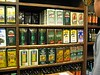 The wall of olive oil in large cans.