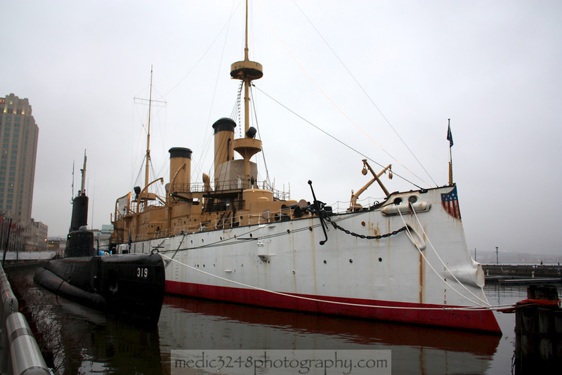 The USS Olympia and the USS Becuna (SS-319), a WWII Balao Class Diesel attack sub.