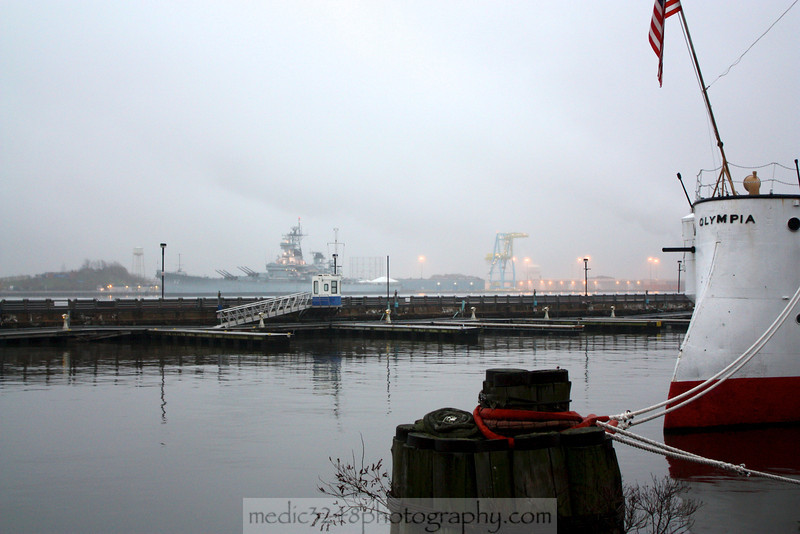 The USS New Jersey (BB-62), one of the last battleships built in the world on the NJ side of the Delaware RIver fittingly sits across from the USS Olympia, a predecessor to the more modern floating battery of mayhem.