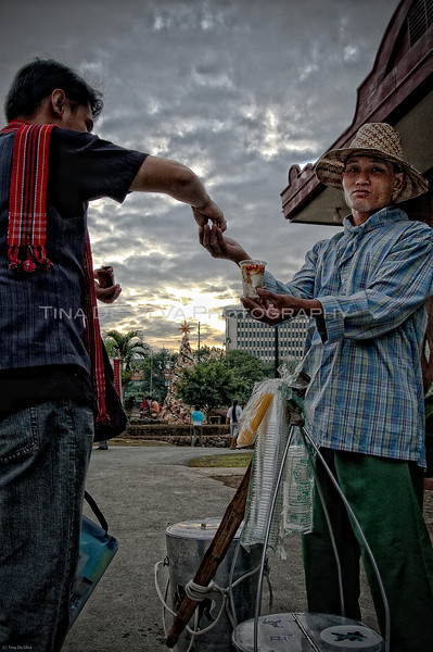 "Taho Man<br /> This guy sells ""taho,"" which is a sweet soy bean curd native refreshment, a well-known trademark of the Philippine Islands.<br /> Intramuros, Manila<br /> Philippines"