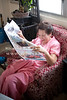My sister, Mary Ann (Pin) relaxing with the local daily.