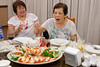 Cousin Joan getting out of the way. As my sister, Pin, goes after the prawns.