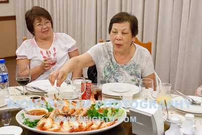 Cousin Joan getting out of the way. As my sister, Pin, goes after the prawns