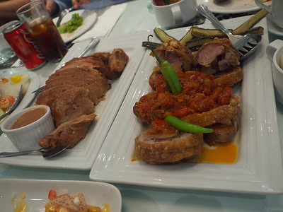 their take on crispy pata, with bagoong and tomatoes on top.