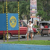Julie with a Rotary sign in Puerto Princesa  (she's going to India in February on a Rotary Exchange).