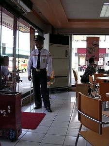 Armed gaurd at Chow King, a fast food eatery in Iligan City