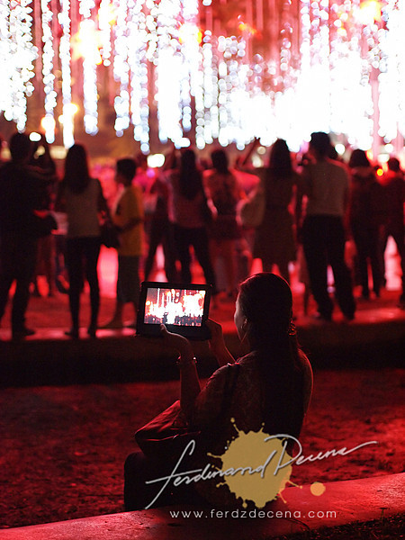A lady capturing the lights from her iPad