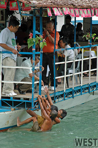 Local kids dive for money.  Or this tourist just handed it to them.
