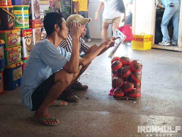 A couple of vendors sharing news at Langihan Bus Terminal