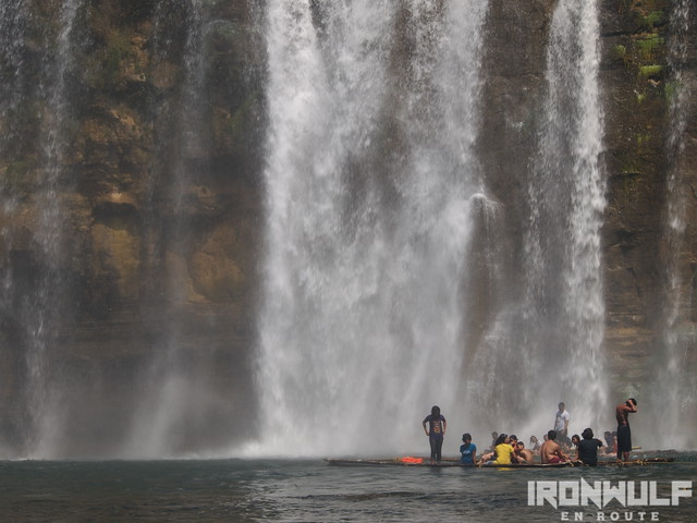 People enjoying the falls while riding on the rafts to get closer
