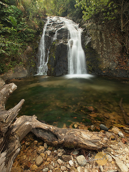 Mabnang Falls surrounded by lush vegetation