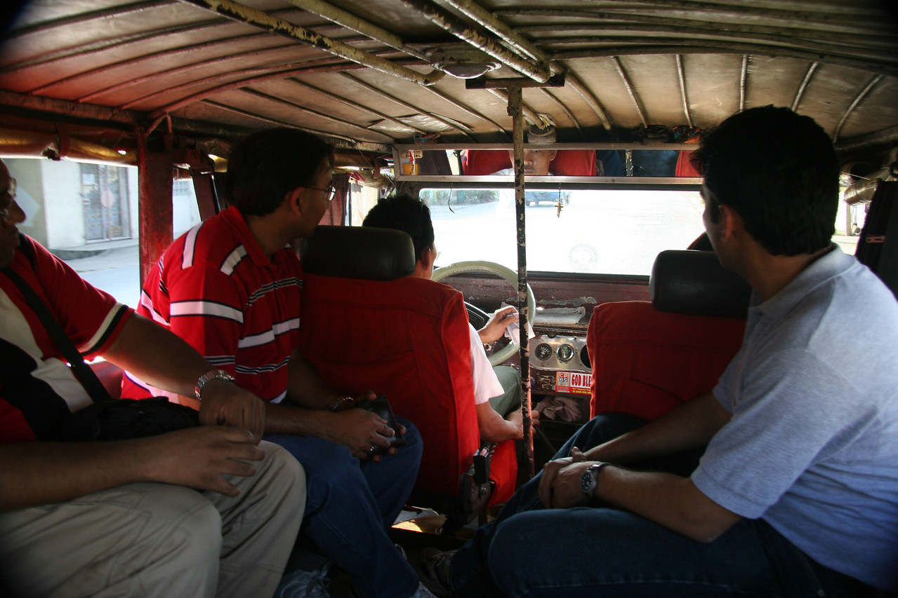 We're riding a Jeepney here back from the river.  Local means of travel, just like a normal bus.