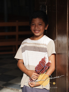 Our Lady of Caysasay Church Boy Candle Vendor