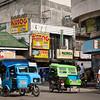 In Tagbilaran city, Bohol: I like the billboards with pork-food ads.