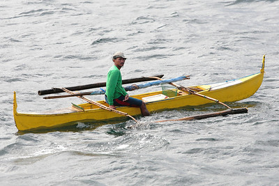 Fisherman in Manila Bay