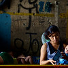 Santa Mesa community of homeless living next to the train tracks below an underpass in Manila