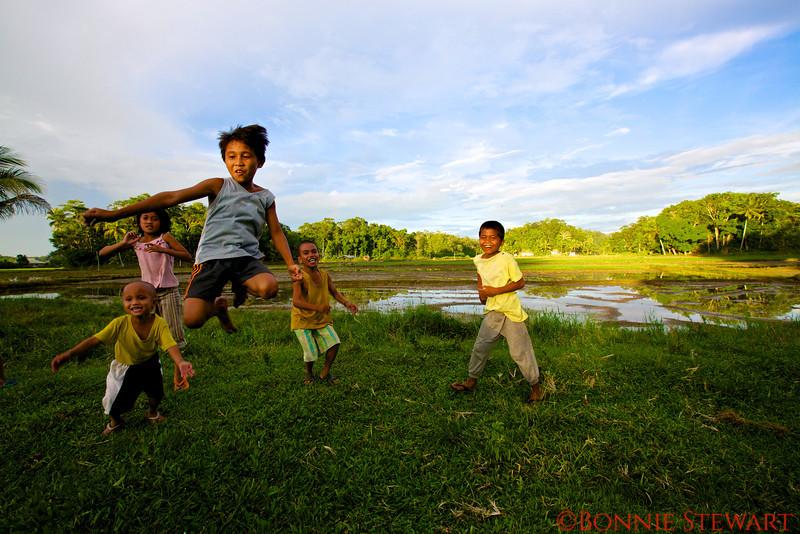 Local village children doing a jump shot