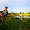 Local village children doing a jump shot