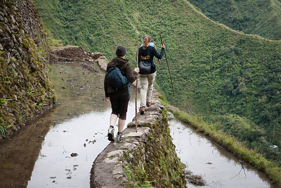 This is how you hike in the rice terraces: on the terrace, there's obviously a muddy rice field - so there's only the narrow the wall to walk on.
