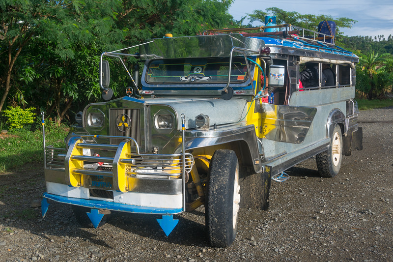 The ubiquitous Jeepney of the Philippines--noisy, uncomfortable, diesel fumes belching, and much beloved. General Nakar, Luzon, October 2016. [General Nakar 2016-10 001 Luzon-Philippines]