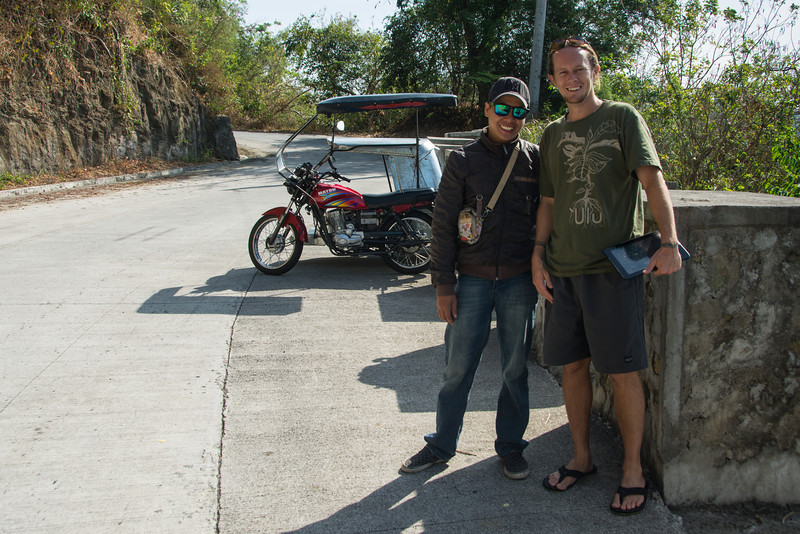 Jason Fox and Paul, the moped driver, Lake Taal, March 2014.