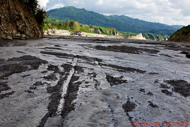 Base of Mt. Pinatubo volcano.   This photo shows the path that the 4-wheeled vehicle traversed to reach the base of the crater where passage was on foot to the rim of the crater lake