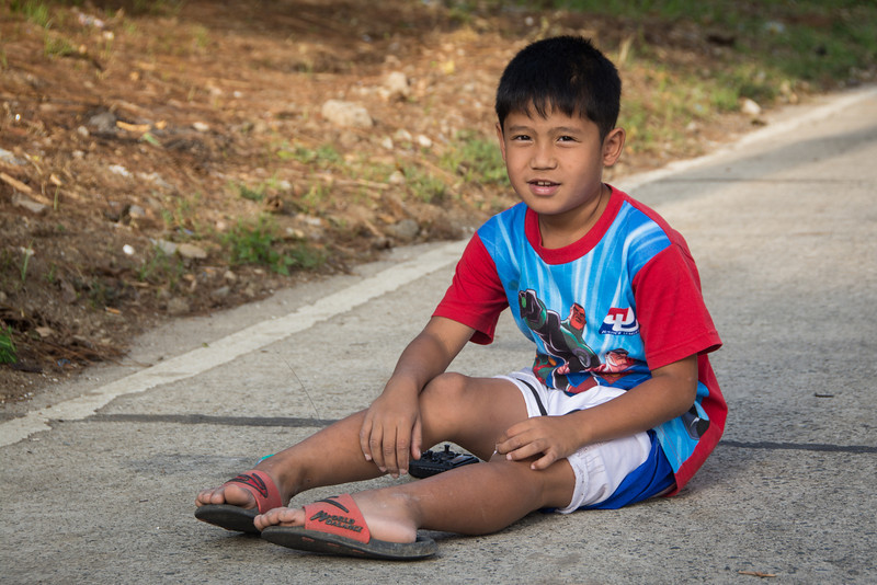 Friendly boy playing on the from Tagaytay descending to Lake Taal, March 2014.
