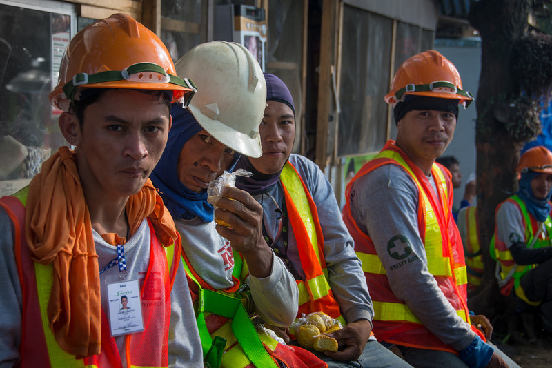 Weary construction workers take a break, Tagaytay, March 2014.