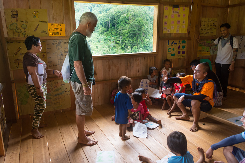 Jesuit priest, Pedro Walpole, greets children at a school he founded in Nabago, Bukidnon Provence, Mindanao, Philippines, June 2017. [Bendum 2017-06 054 Bukidnon-Philippines]
