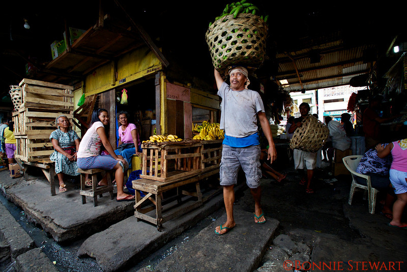 Banana merchant carrying a load of bananas in Cebu