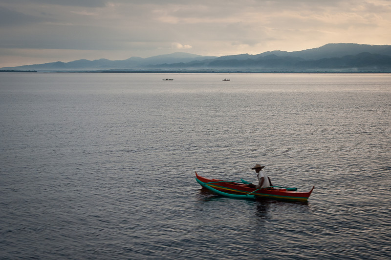 And even early in the morning, there are already plenty of Philippinos out on the sea with their tiny outrigger boats. They didn't look like they were fishing--no idea what they were doing. Maybe it's just a convenient way of locomotion...