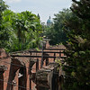 A lot of the remains of Fort Santiagois looks like this - old walls, that have to be held by a metal frame, and inbetween tropical plants over and over! Behind, the cathedral of Intramuros peeks in.
