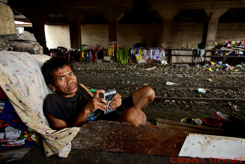 Virginia's friend, also a resident of the Santa Mesa community of homeless living next to the train tracks below an underpass in Manila